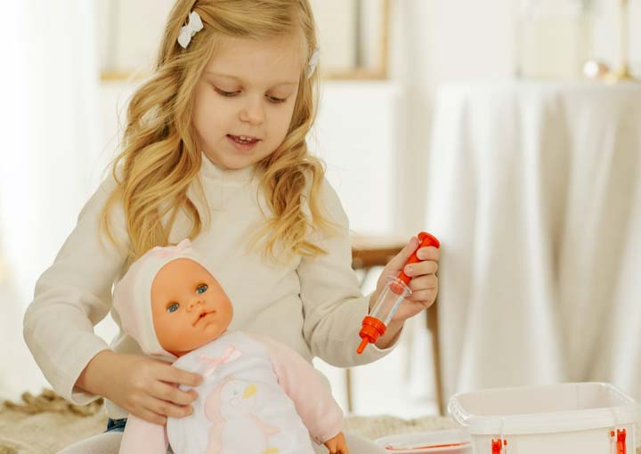 female child role-playing a doctor